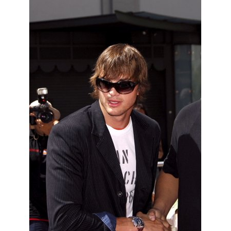 Ashton Kutcher At The Induction Ceremony For Kevin CostnerS Hand And Footprint Ceremony GraumanS Chinese Theatre Hollywood Ca September 06 2006 Photo By Michael GermanaEverett Collection Celebrity